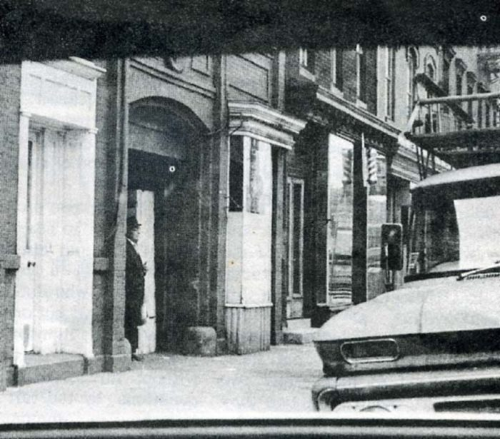 A picture showing an alleged member of the Men In Black in a New York apartment black doorway
