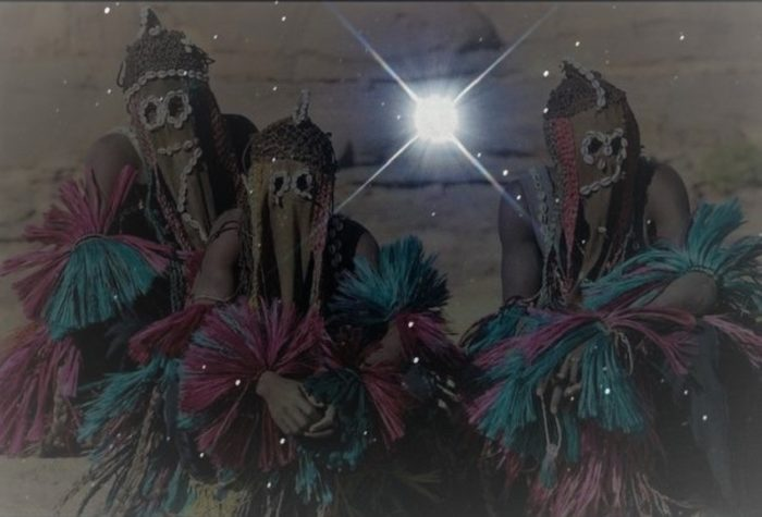 A picture of the Dogon tribe members with a picture of Sirius superimposed over the top