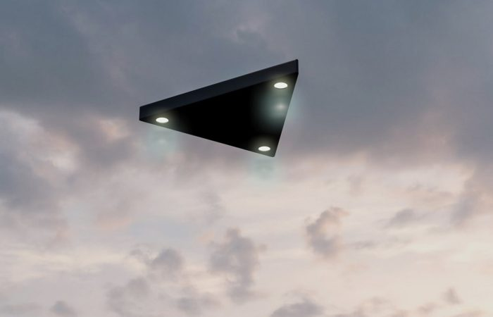 A black triangle UFO in the daytime sky