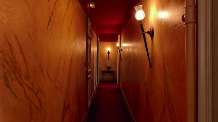 A long old-fashioned hotel corridor