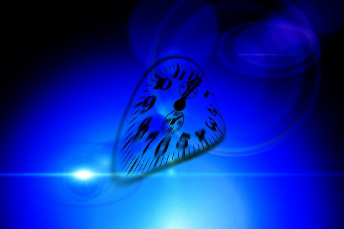 A warped clock face on a deep blue background