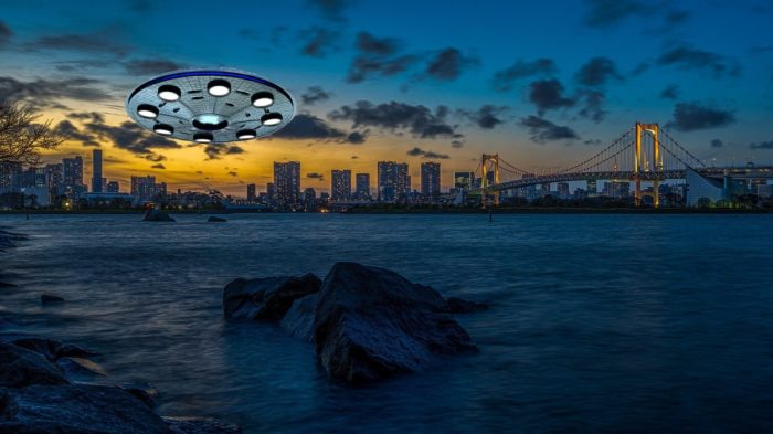 A UFO superimposed on to a picture of the water with a city in the background