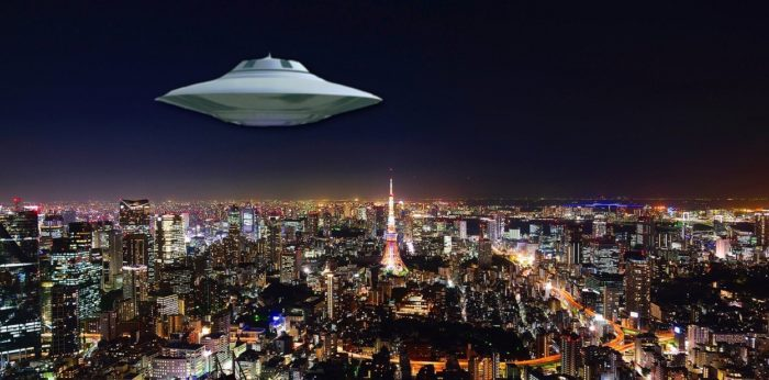 A UFO superimposed on to a picture of a Japanese city at night