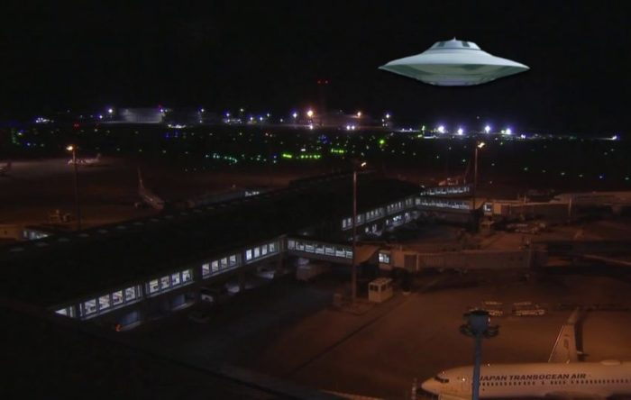 A UFO superimposed on to a picture of an air base at night
