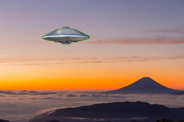 A UFO superimposed onto a picture of large mountain