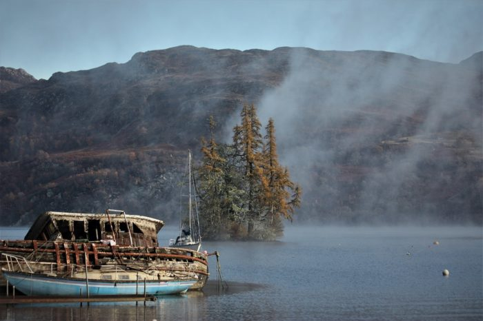 A ruined boat on the waters of Loch Ness