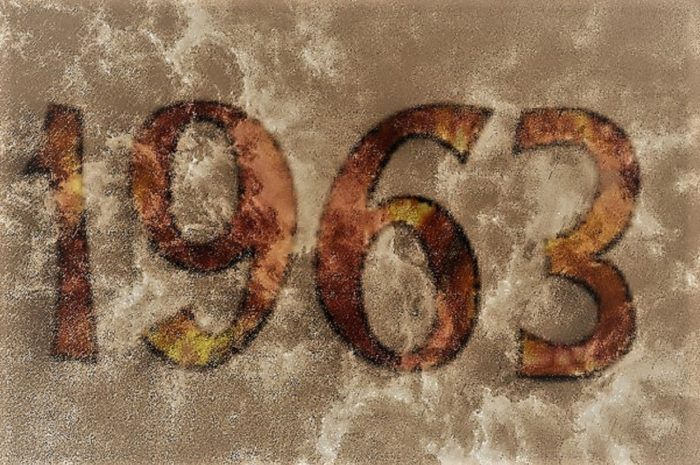 A dark brown-grey background with the numbers 1963 over the top