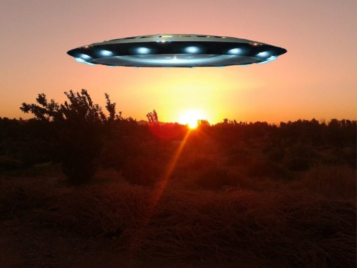 A sunset picture with a superimposed UFO over the top