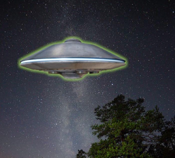 A superimposed UFO in a night sky