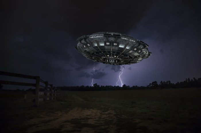UFO over farmland at night