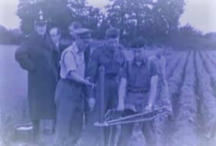 Military personnel investigate the scene of the alleged landing