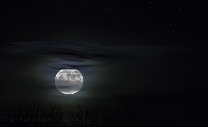 A full moon in a night sky