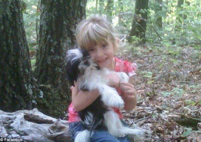 Madyson Jamison holding her dog