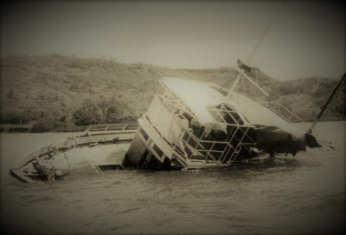Port side of the floating wreck of the MV Joyita