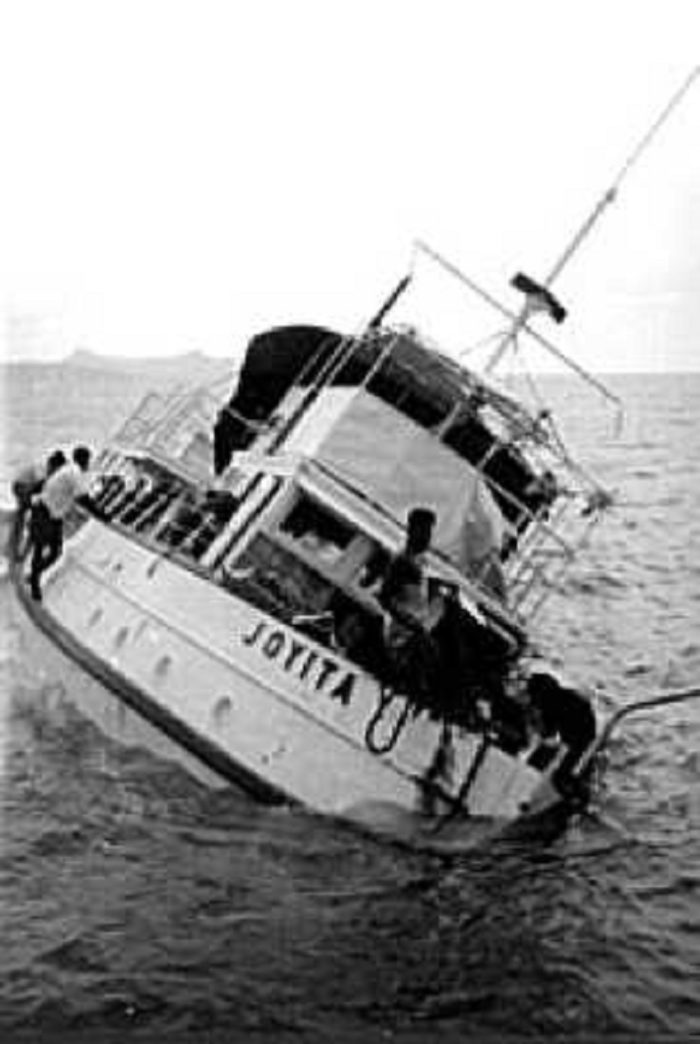 Rescuers examining the remains of the MV Joyita
