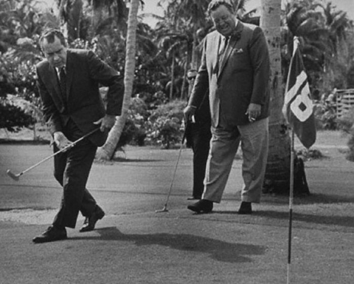 Richard Nixon playing golf with Jackie Gleason in Florida, 1974