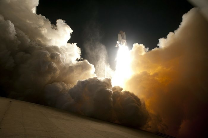 A picture of a shuttle launching