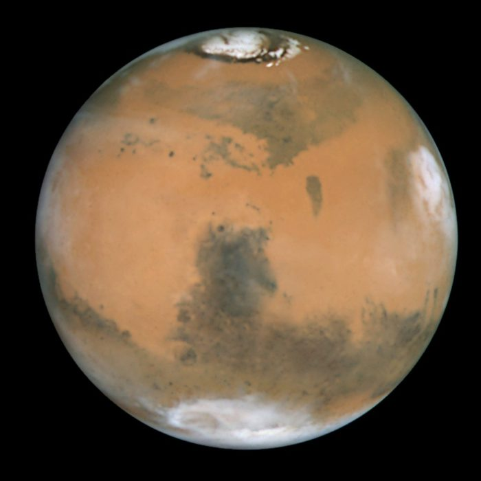 Picture of Mars showing clearing the ice caps at the polar regions