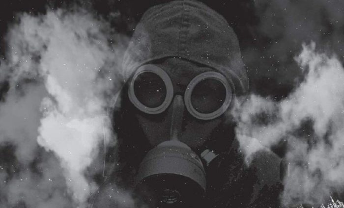 A picture of a person with a gas mask on