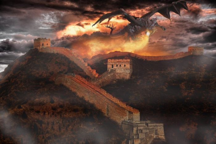 A picture of a dragon breathing fire over a castle