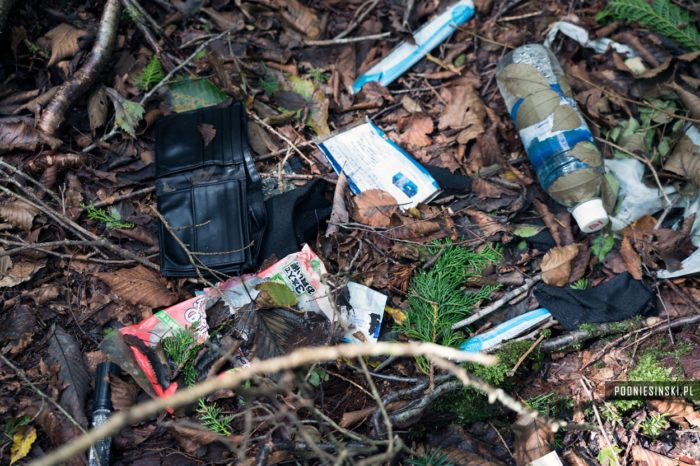 A picture of discarded belongings on the forest floor