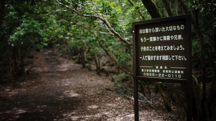 A sign warning against suicide in the Suicide Forest
