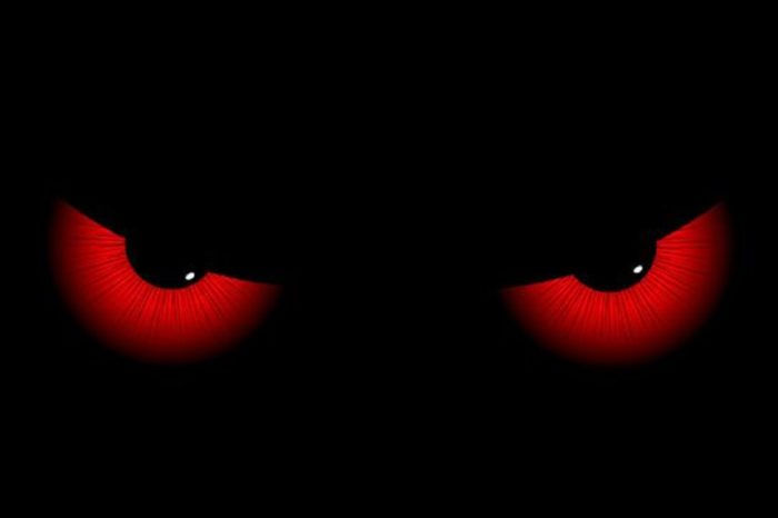 A drawing of glowing red eyes