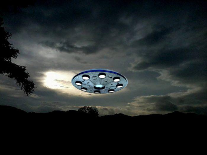 Superimposed UFO in a night sky