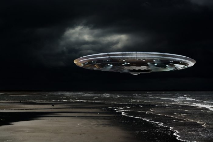 Superimposed UFO onto a beach at night