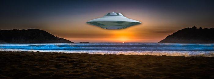 A UFO superimposed onto a sunset beach