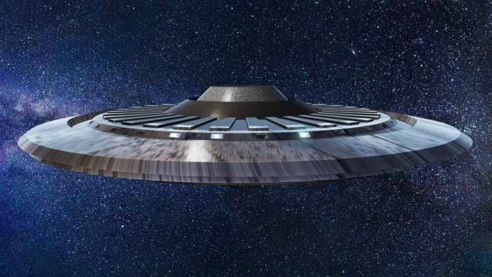 Superimposed UFO on a starry sky