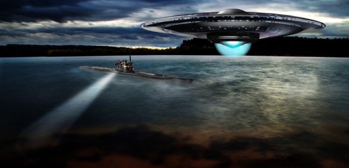 A depiction of a UFO over a submarine
