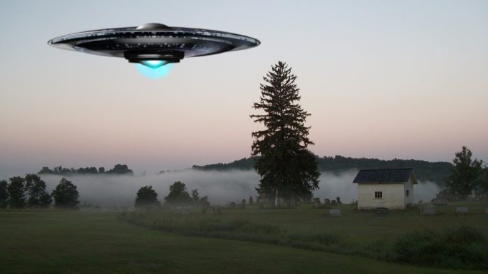 A superimposed UFO over a field
