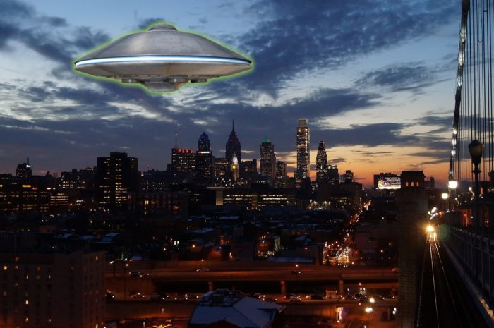 A superimposed UFO over a city at dusk