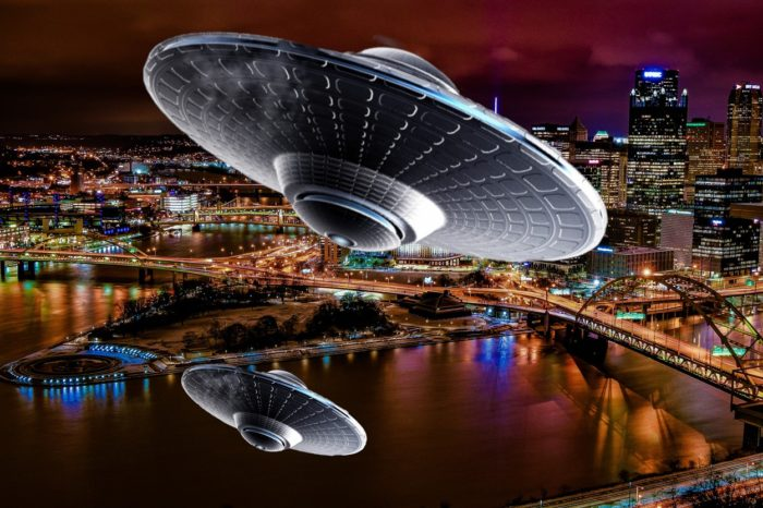 Two superimposed UFOs over a lake