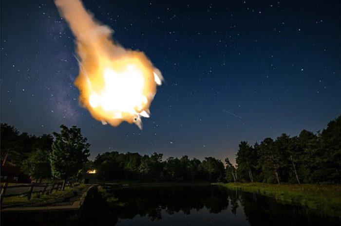 A superimposed fireball over a lake