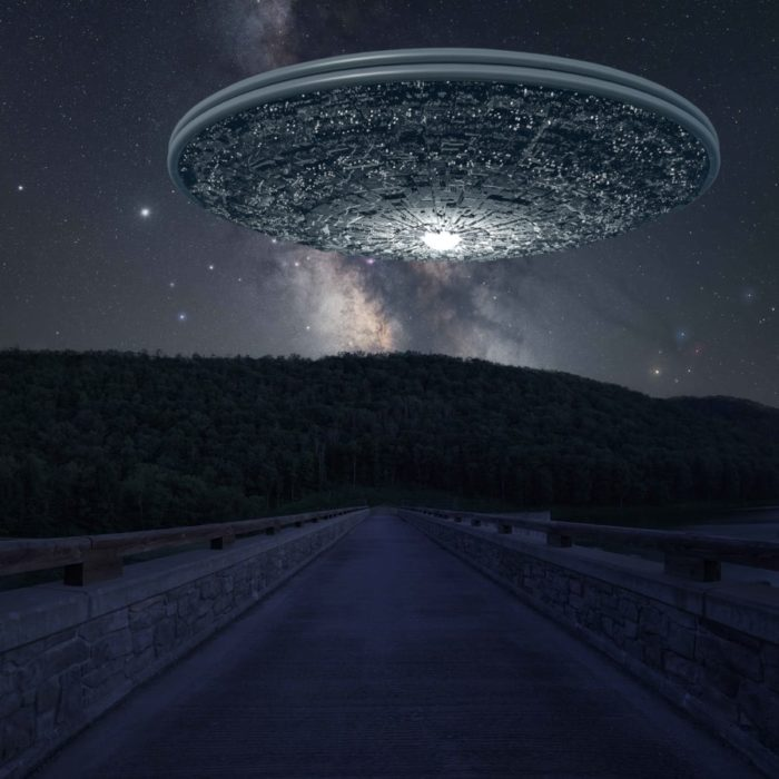 A superimposed UFO over a quiet road