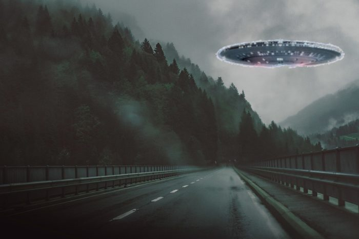 Superimposed UFO over a road