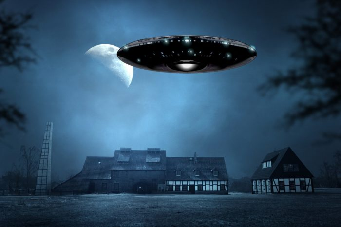 A superimposed UFO over a quiet country house