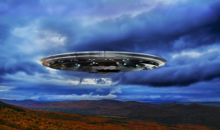 A superimposed UFO over the countryside
