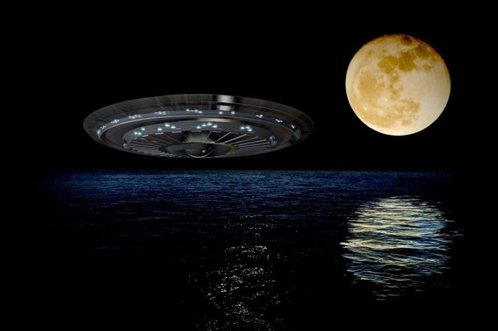 A superimposed UFO over the ocean at night