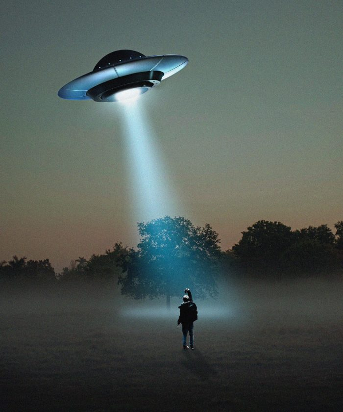 A depiction of a flying saucer over a person