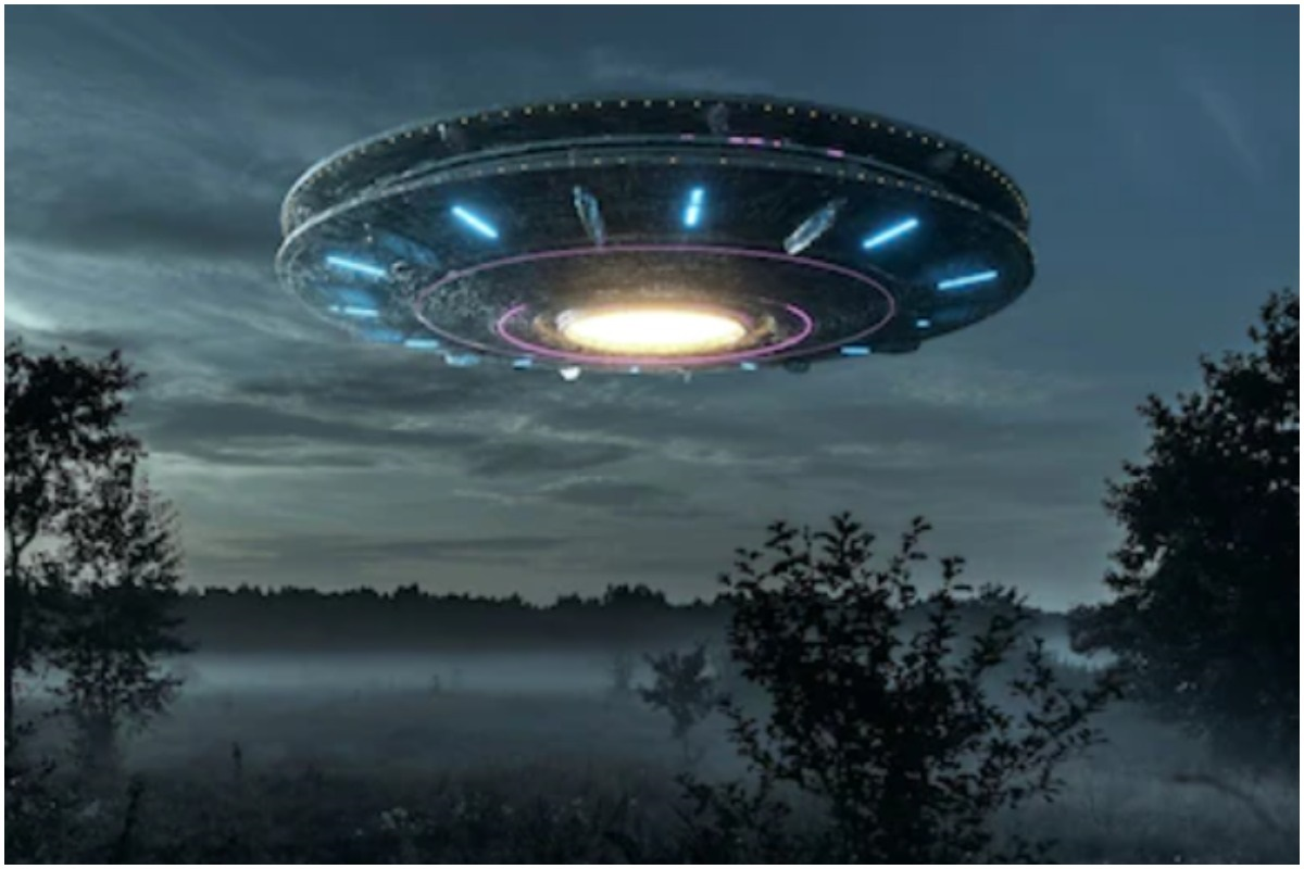 Depiction of a UFO over a forest