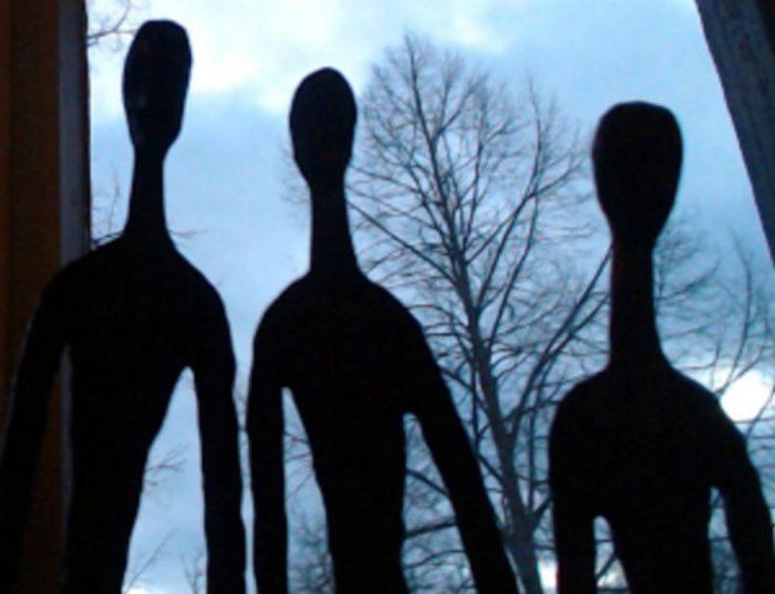 Shadows of three alien entities